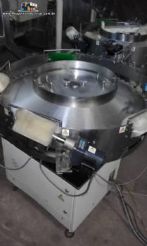 Alimentador rotativo de balas e chicletes para máquinas tipo Flow Pack